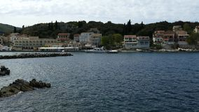 The Village of Kassiopi, Corfu Island, Greece. Rocky coast of Ionian Sea and houses on the hill.  stock footage
