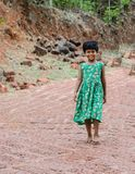 Girl child in a village walking downhill royalty free stock photography