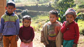 Village kids in Himalayan mountains. 4 young scruffy kids in Himalayan village in northeast India Stock Photo