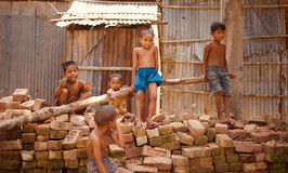 Village kids sitting around a place. Isolated unique photo royalty free stock photo