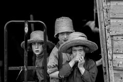 Village kids in straw hats. Stock Photography