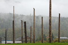 Village of Kispiox, BC with an array of traditional totem poles Royalty Free Stock Image