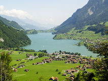 Village on the lake. Landscape of Switzerland countryside. In background big mounatins Stock Image