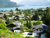 Village on the lake. Small village on the lake. Austrian Alps Royalty Free Stock Image