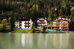 The village and the lake Alleghe Royalty Free Stock Images