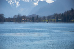Village with lake and Alps background Royalty Free Stock Photo