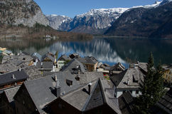 Village with lake and Alps range background Stock Photos