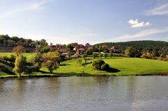 Village on lake Stock Images