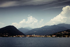 Village on the lake. Intra village on the Great Lake (Lago Maggiore) with mountains in the background. North of Italy Royalty Free Stock Images