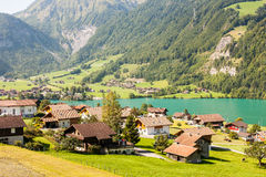 Village on the Lake Lungern in Switzerland. Idyllic segment of the famous Lake Lungern in Switzerland Stock Images