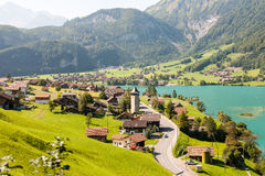 Village on the Lake Lungern in Switzerland. Idyllic segment of the famous Lake Lungern in Switzerland Royalty Free Stock Photo
