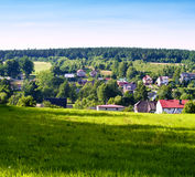 Village landscape. Lovely village among the forests and meadows Royalty Free Stock Photo