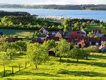 Village landscape lakeside at spring by sunlight stock photos