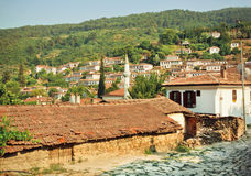 Village landscape with minaret and tiled roofs of Turkey Royalty Free Stock Photography