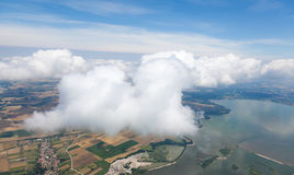 Village landscape over clouds royalty free stock photo