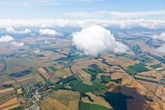 Village landscape over clouds Stock Image