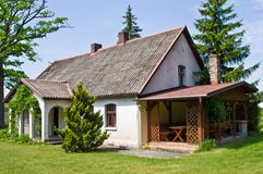 Pastoral rural house in northern Poland. Village landscape, pastoral rural house with barbeque area, northern Poland. Outdoor architecture royalty free stock photography