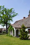 Pastoral rural house in northern Poland. Village landscape, pastoral rural house with barbeque area, northern Poland. Outdoor architecture stock photography
