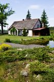 Pastoral rural house in northern Poland. Village landscape, pastoral rural house with barbeque area, northern Poland. Outdoor architecture. Pond reflection stock images