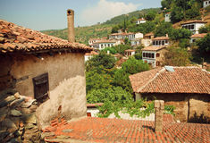 Village landscape with tiled roofs of old rustic houses Royalty Free Stock Photo