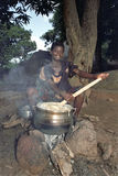 Village life with cooking Ghanaian young woman Royalty Free Stock Images