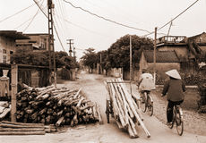 Village life, Vietnam. Sepia-toned image of the main street in a village outside Hanoi, Vietnam stock photo