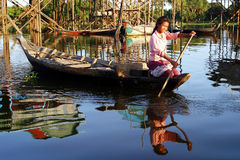 Village lifestyle, Cambodia. Village lifestyle in Kampong Phluk, Cambodia. A young local girl travels around by her tiny boat Royalty Free Stock Images