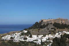 The village Lindos with Acropolis, Rhodes Royalty Free Stock Photo