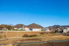 Village is located in front of the mountain and the front is for agriculture. The village is located in front of the mountain and the front is for agriculture stock images