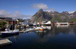 Village on Lofoten islands. Fishermans cabins and harbour of Hamnoy on Lofoten islands, Norway with mountains in the background Stock Photography