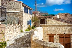 Village of Lofou, traditional stone houses obbled stone street. Stock Photography