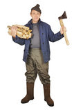 Village man with an axe and woods Royalty Free Stock Photos