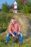 Village man near the haystack Stock Photography