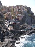 Village of Manarola on cliffs above Ligurian Sea. Italy, Cinque Terre, village of Manarola on cliffs above Ligurian Sea Royalty Free Stock Photography
