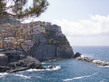 Village of Manarola on cliffs above Ligurian Sea. Italy, Cinque Terre, village of Manarola on cliffs above Ligurian Sea Stock Photo