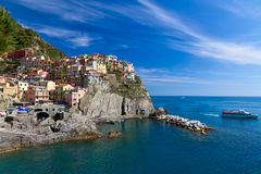 Village of Manarola with ferry, Cinque Terre, Italy Royalty Free Stock Photos