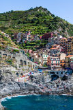 Village of Manarola with ferry, Cinque Terre, Italy Stock Images