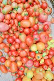 Village market colorful tomatoes. Group of mix tomatoes. Tomato pile for sale at farmers market. Fresh tasty tomatoes. Ripe tomatoes background. Fresh colorful Stock Photo