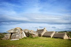 House between the rocks in Meneham village, Kerlouan, Finistere, Brittany Bretagne, France. The village of Meneham, located in Pagan county Pagan bro, was Stock Photography