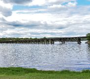Village of Merrimac Rail Road Bridge In Wisconsin. Under partly cloudy skies sits the rail road bridge expanding across lake Wisconsin in the Village of Merrimac stock image