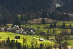 Village in the midst of spring fields Slovenia stock photography
