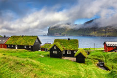 Village of Mikladalur, Faroe Islands, Denmark. Village of Mikladalur located on the island of Kalsoy, Faroe Islands, Denmark royalty free stock photos