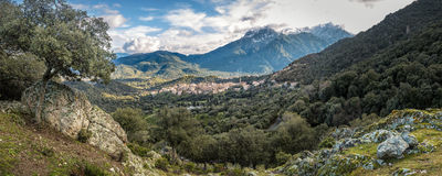 Village of Moltifao in Corsica with snow covered mountains behin Royalty Free Stock Photography