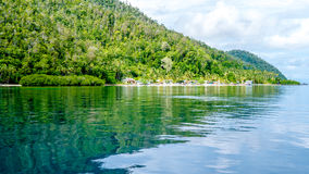 Village on Monsuar Island. Raja Ampat, Indonesia, West Papua Royalty Free Stock Image