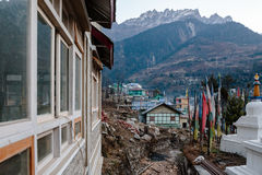 Village in the morning with stupa, Tibetan prayer flags with mountain in background in winter at Lachung in winter. North Sikkim Stock Photos