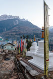 Village in the morning with stupa, Tibetan prayer flags with mountain in background in winter at Lachung in winter. North Sikkim Stock Image
