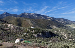 Village in the mountain. A massive landscape surrounded by trees, in the village of Zahara de la sierra in Spain. You can see a white house in the mountain Stock Photo