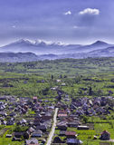 Village and Mountain Stock Photography
