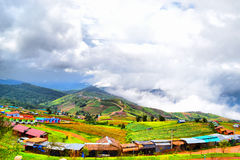 Village. On the mountain peak is cool air Royalty Free Stock Images