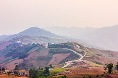 Village mountain, Phu Tub Burg, Thailand. The village and road on top of mountain Stock Image
